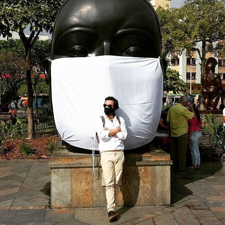 Carlos Cadena Gaitán of La Ciudad Verde poses in front of a masked Botero (photo via @cadenagaitan/Instagram)