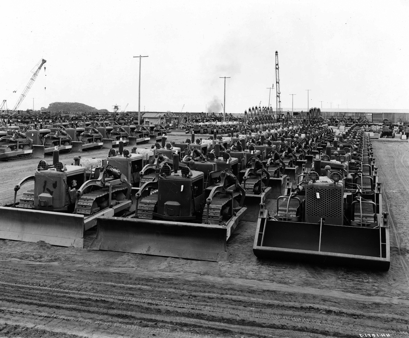International Harvester bulldozers lined up for war (courtesy Yale University Press)