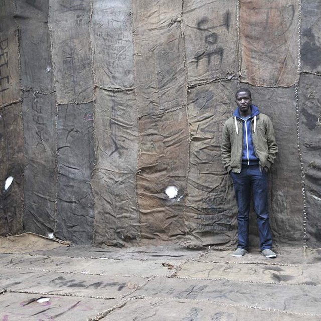 """Ibrahim Mahama in his installation """"Civil Occupation"""" at Ellis King in 2014 (photo by @jonathanellisking/Instagram)"""