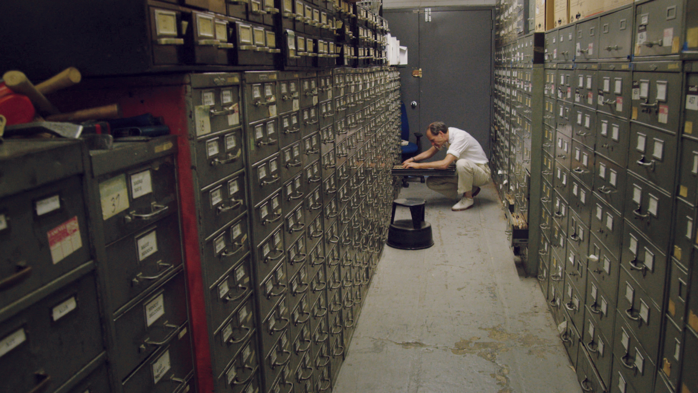 """Jeff Roth searching the archives in the New York Times' """"Morgue"""" (photo by Ben Wolf)"""