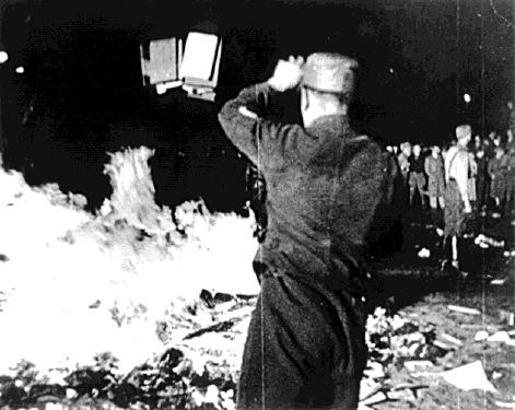 "On May 10, 1933, Nazis in Berlin burned works by leftists and other authors considered ""un-German"", including thousands of books looted from the library of Hirschfeld's Institut für Sexualwissenschaft. (in the collection of the US National Archives, via Wikipedia)"