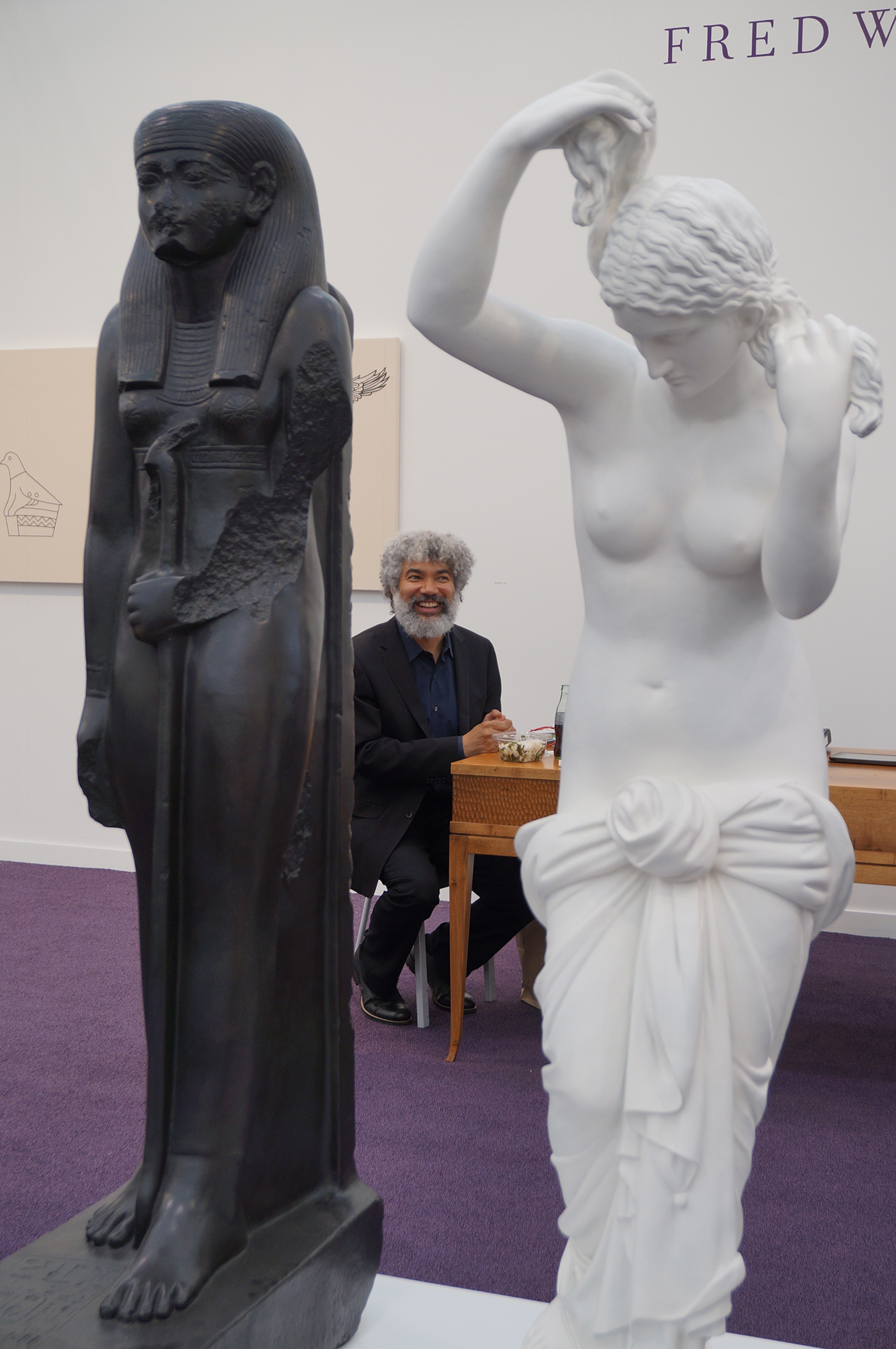 "Fred Wilson sandwiched between his ""The Mete of the Muse"" (2006)"