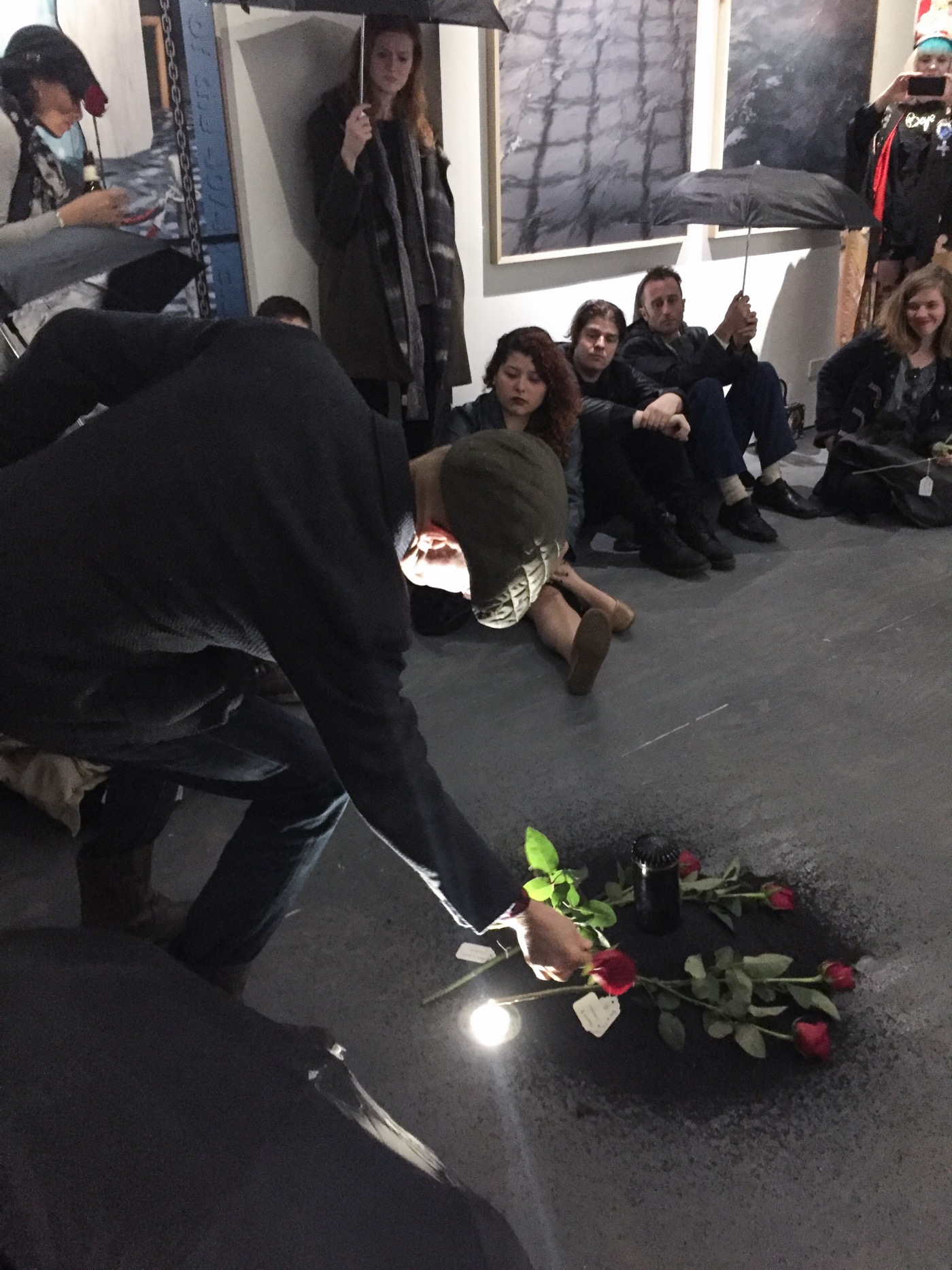 During Butz' performance audience members lay flowers on an earthen mound. Photo by Ventiko