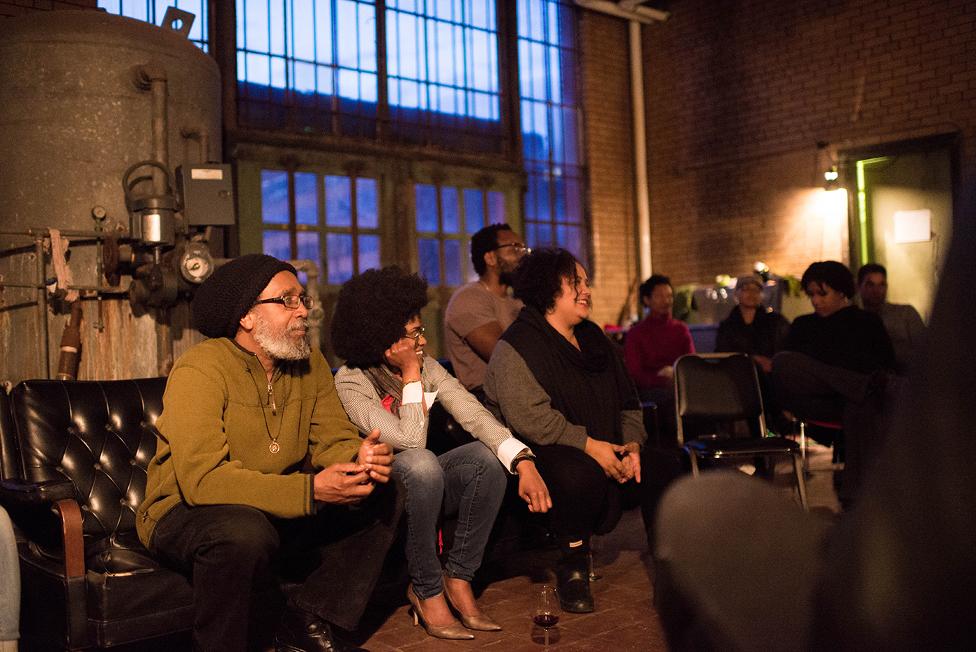 Malik Yakini (Detroit Black Community Food Security Network), Pashon Murray (Detroit Dirt), and Dream Hampton (writer) participate in post dinner panel on food justice in Detroit. (photo by Justin Millhouse)