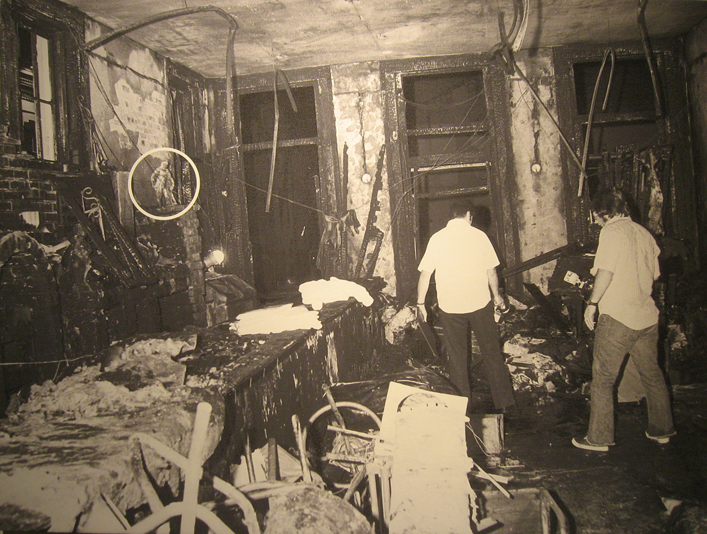 "A photo of the fire wreckage of the Upstairs Lounge with a circle indicating the original position of the ""Farnese Hercules"" in the bar."