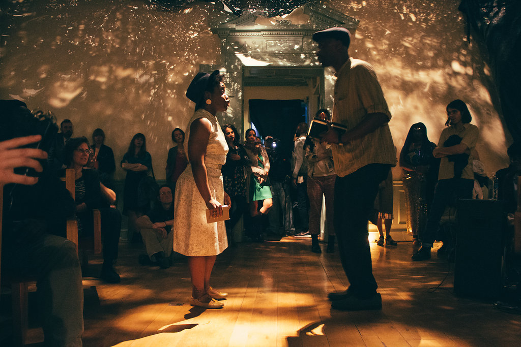 A performance taking place in Abigail DeVille's 'Only When It's Dark Enough Can You See The Stars' at the former Peale Museum