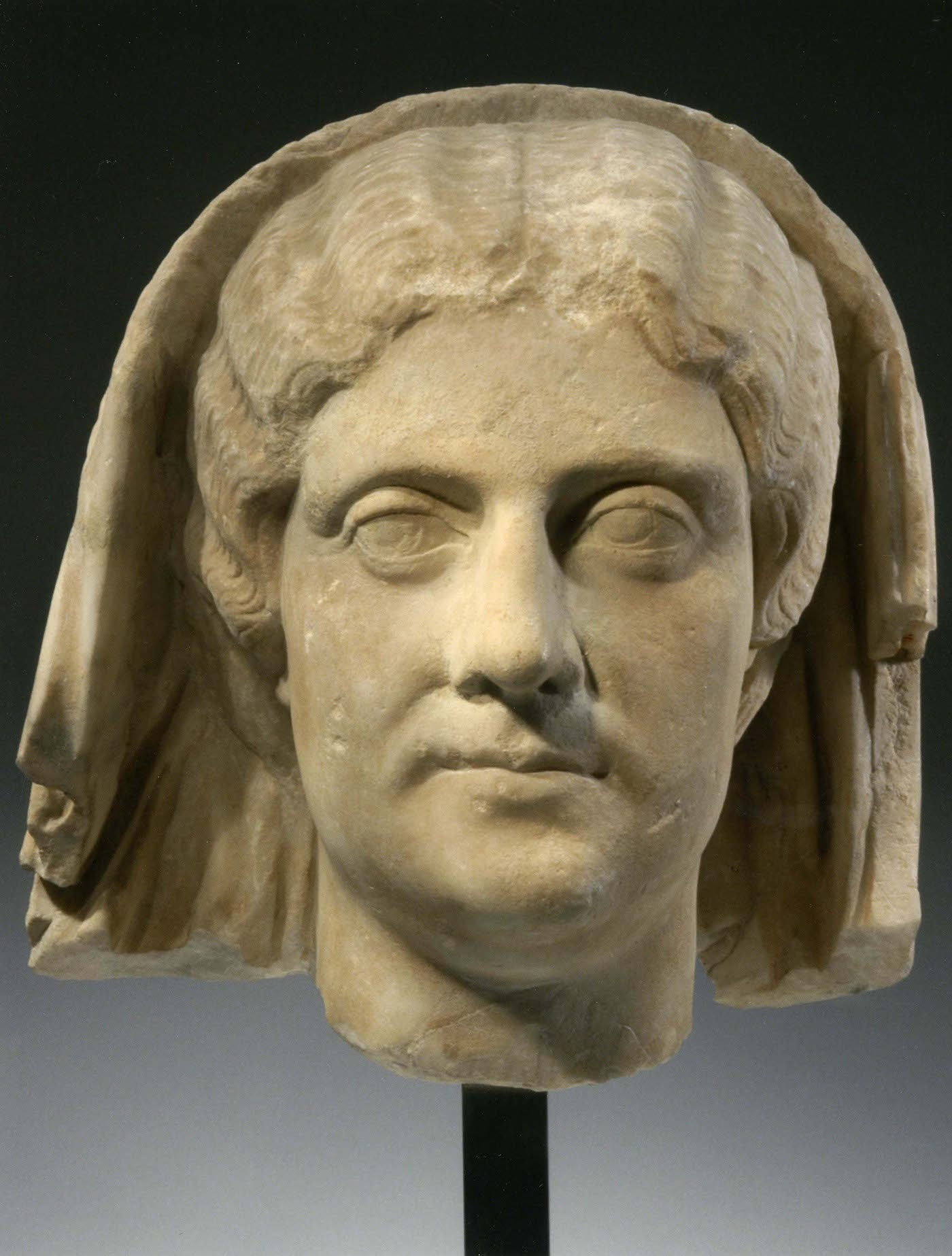 Head of a veiled woman, (CE 175), Roman, marble, 13 inches (courtesy the J. Paul Getty Museum)