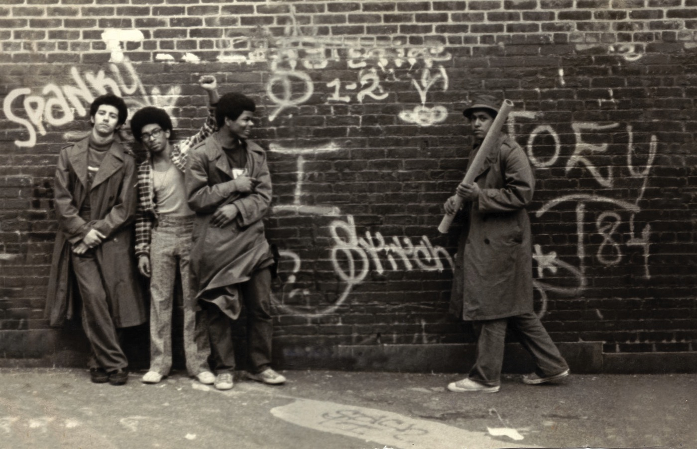 """SNAKE 1, STATIC 5, FLASH 191, and STITCH 1 at the P.S. 189 school yard in Washington Heights, New York. Circa 1973. From the film """"Wall Writers (Photo courtesy SNAKE 1, via wallwritersthemovie.com)"""