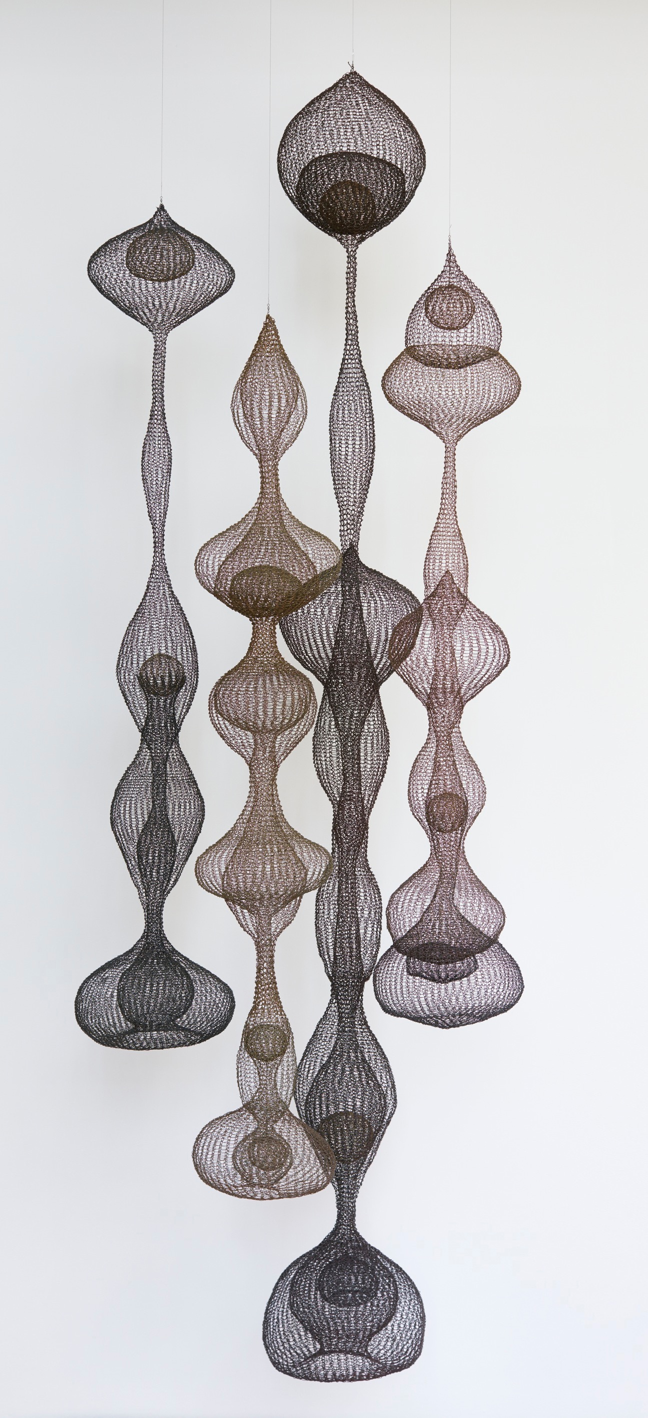 Ruth Asawa Untitled [S.228, Hanging Six-Lobed, Discontinuous Surface (three sections) with Interlocked Top Section] ca. 1962 Copper and brass wire, naturally oxidized 96 x 17 x 17 in / 243.8 x 43.2 x 43.2 cm © Estate of Ruth Asawa Estate of Ruth Asawa, courtesy Christie's Photo: JKA Photography