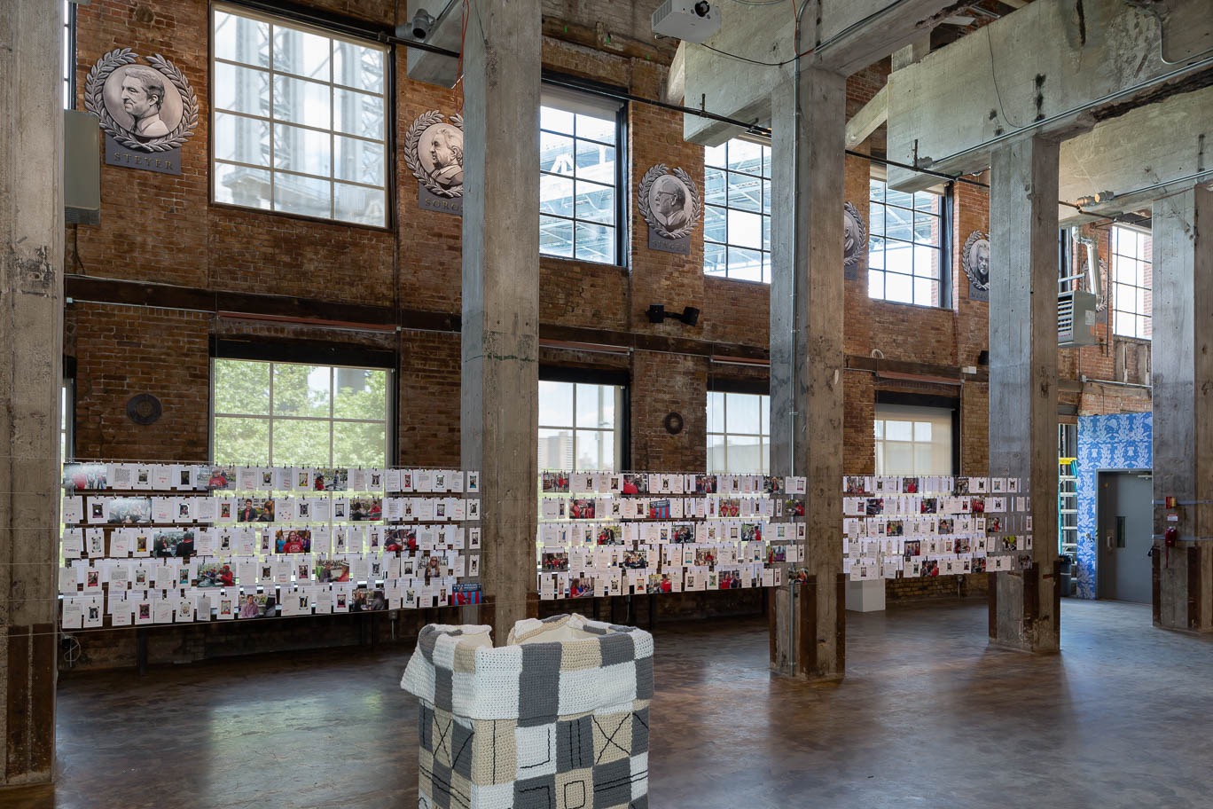 """Installation view, with Sheryl Oring's, """"I Wish to Say"""" (2016) suspended between pillars on the left."""