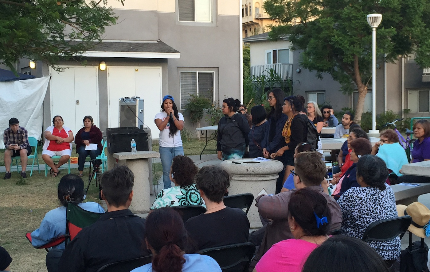 Members of Defend Boyle Heights address the crowd at Pico Gardens