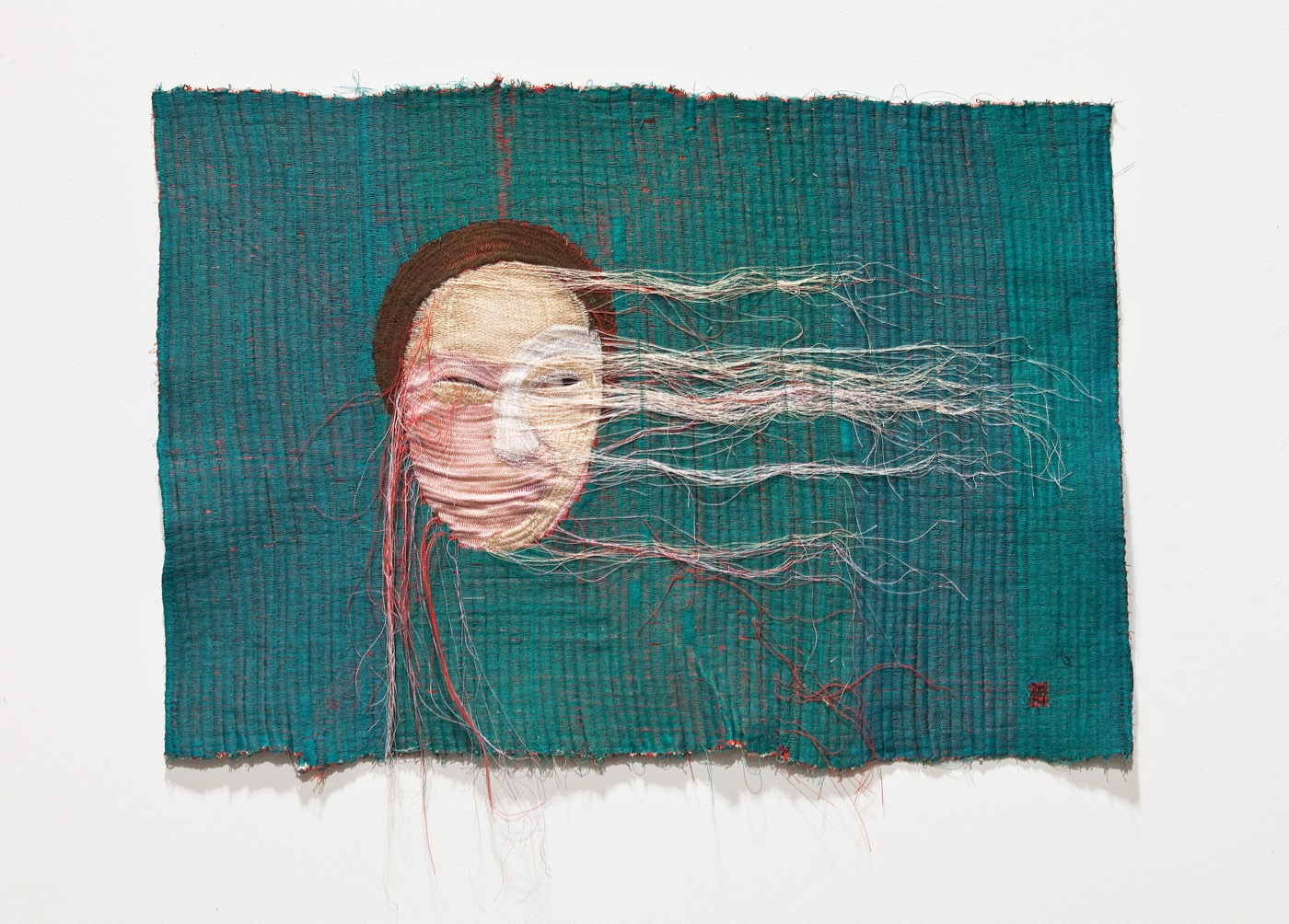Yoon Ji Seon, Rag face #10, 2012 Sewing on fabric and photograph, 18 ½ x 26 7/16 in Courtesy the Artist andYossi Milo Gallery, New York