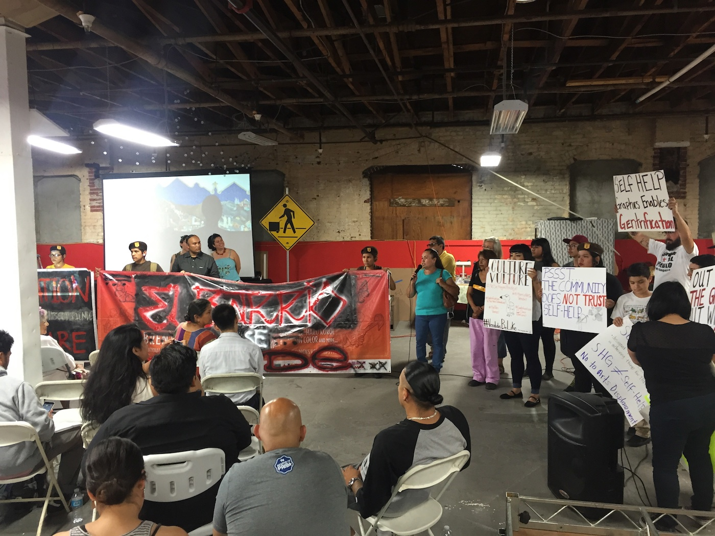 Defend Boyle Heights disrupts a meeting at Self-Help Graphics on July 2