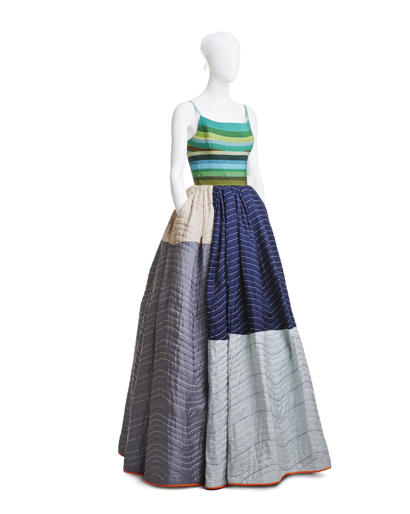 Elevator Pad Gown, grosgrain-ribbon bodice, quilted silk and lambís-wool skirt, spring 2005. Workhorse elevator padding used by movers inspired Mizrahi. He appropriated the quilting technique, but elevated the shipping blanket in a patchwork of blue, green, gray, and silver silk