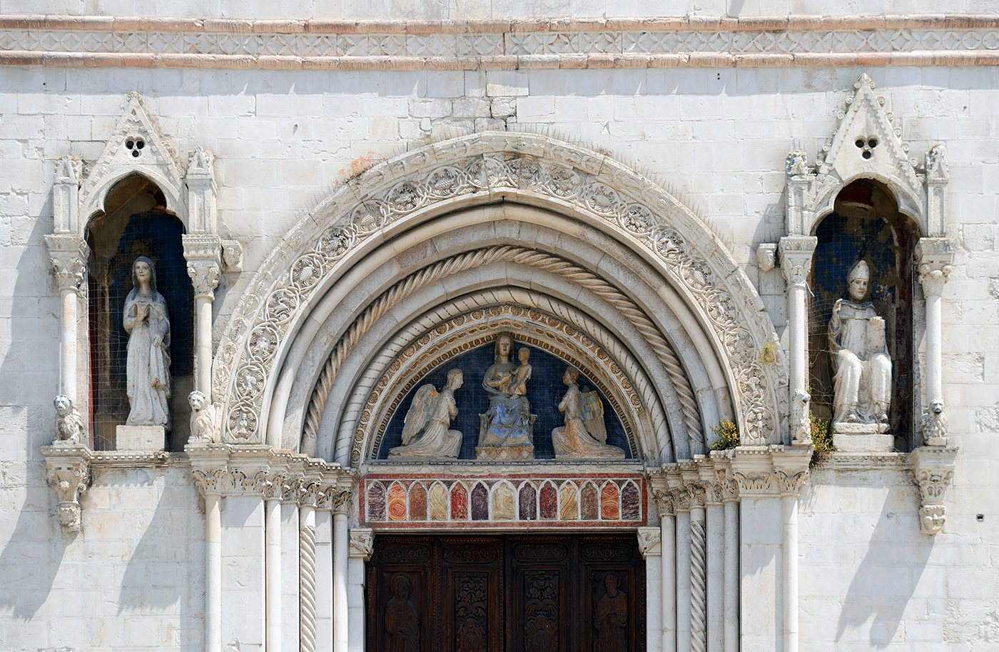 Decoration on the Basilica of St. Benedict in Norcia (photo by Livioandronico2013/Wikimedia Commons) (click to enlarge)