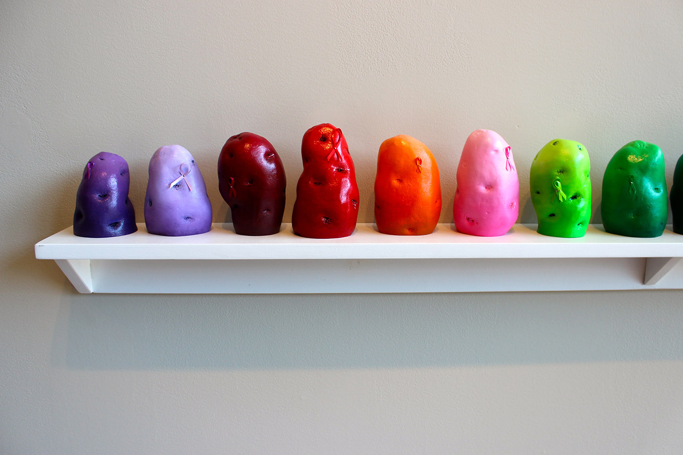 "RaRoCo, ""Awareness Potatoes"" (2016), Lik-wood, polyoptic, enamel, acrylic, laquer, ribbon"