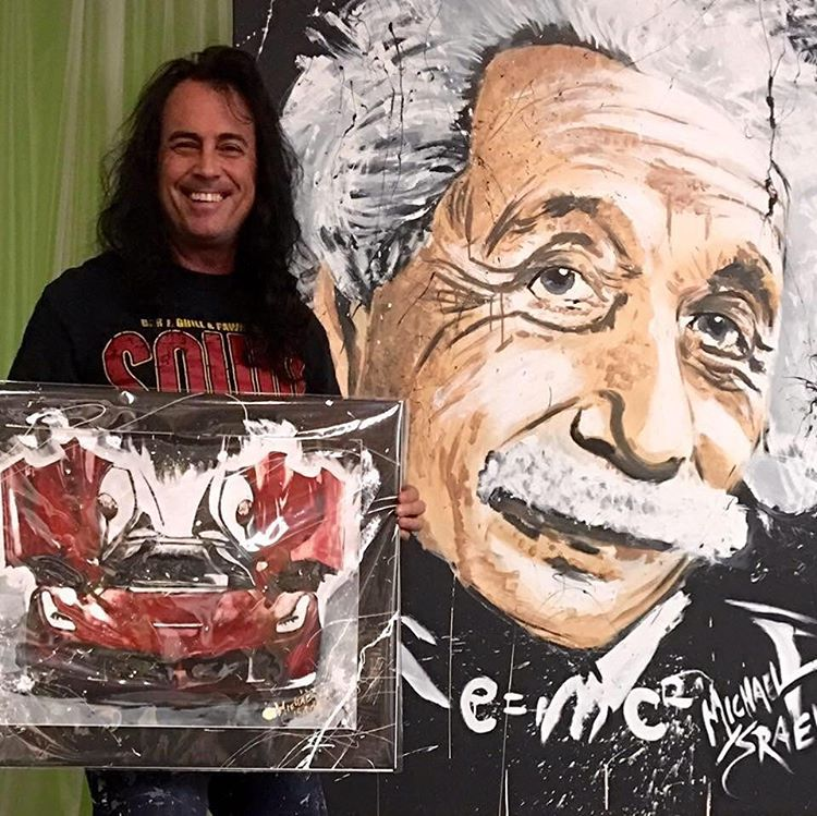 Michael Israel and his paintings (photo via @michaelisraelart/Instagram) (click to enlarge)