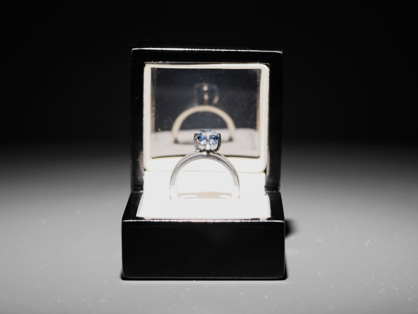 """Jill Magid, """"The Proposal"""" (2016, detail), uncut, 2.02 carat, blue diamond with micro-laser inscription """"I am wholeheartedly yours,"""" silver ring, ring box, documents; setting design by Anndra Neen (photo by Stefan Jaeggi, courtesy Kunst Halle Sankt Gallen)"""