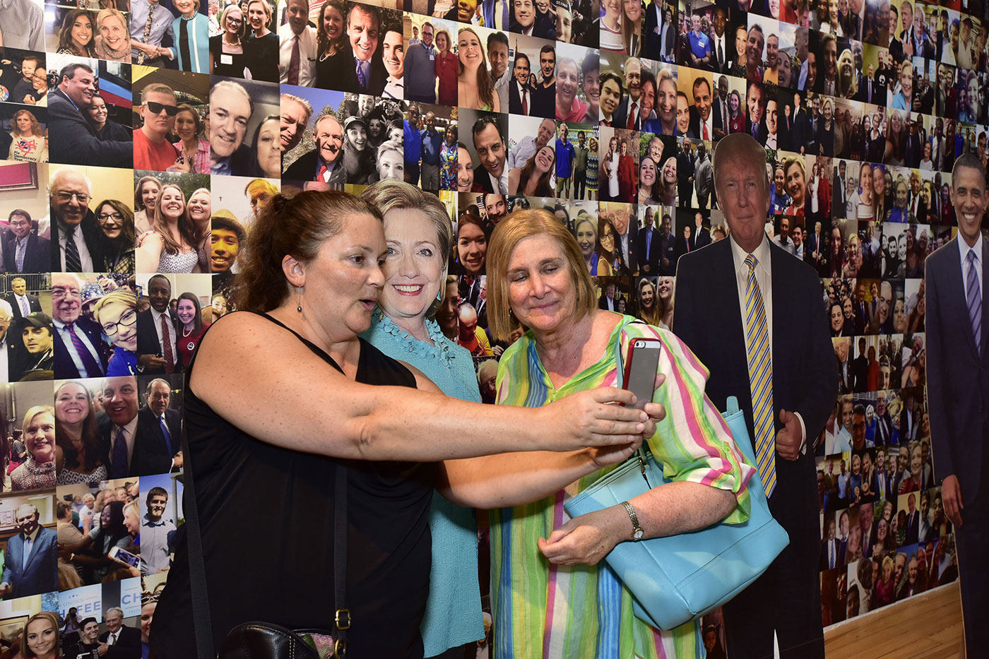 Visitors to the exhibition taking selfies with a life-size cutout of Hillary Clinton (image courtesy the International Center of Photography)