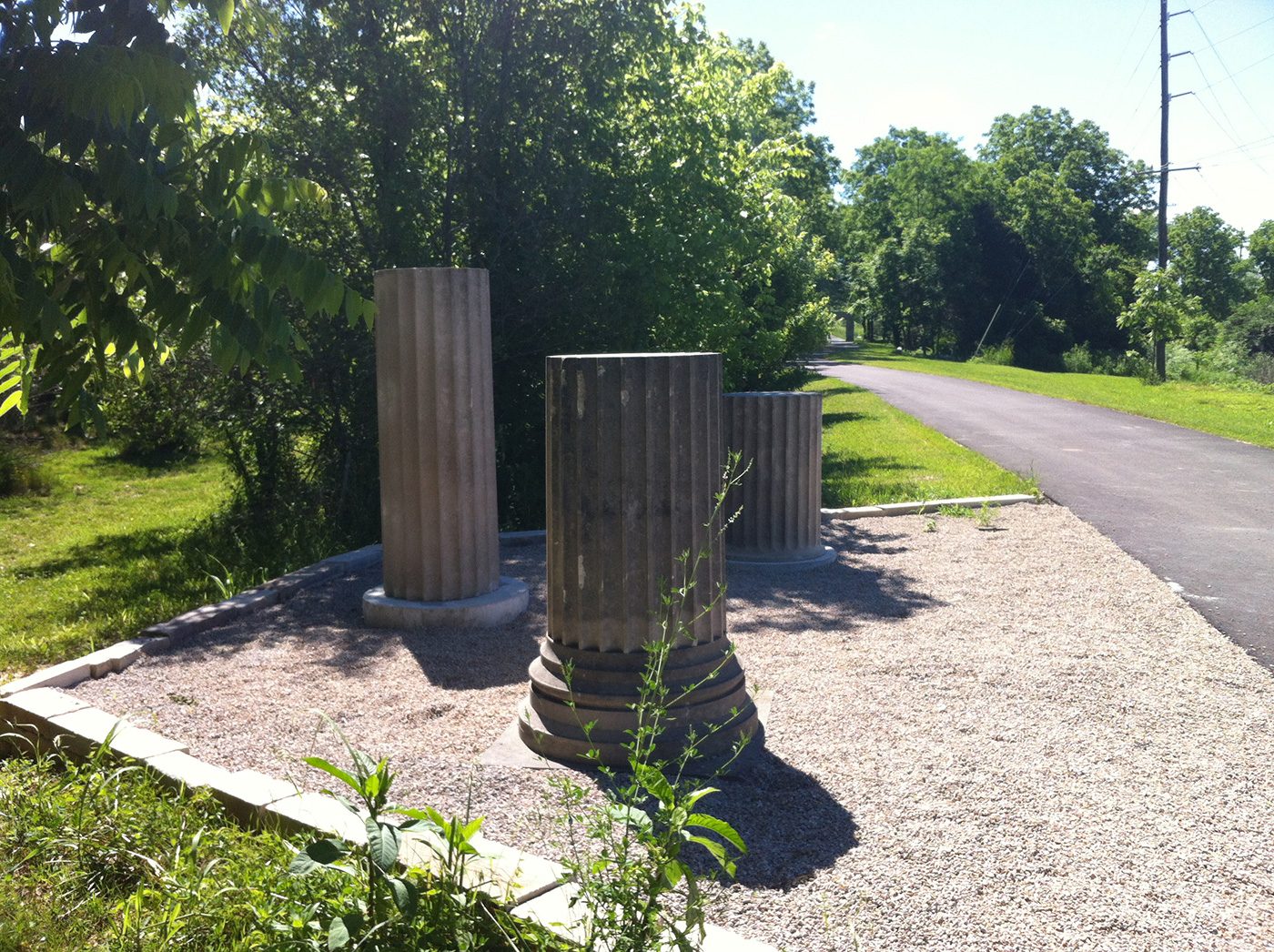 """Ellettsville Heritage Trail, Ellettsville, Indiana, June 2016. The column segment alludes to Ellettsville's important limestone industry and the town's motto, """"Builders of American History""""."""