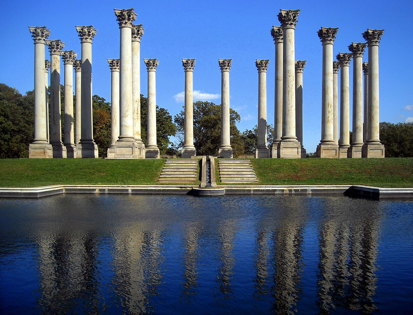 National Capitol Columns: a) 22 of 24 Corinthian columns removed from the United States Capitol in 1958 and set up at the United States National Arboretum, Washington, D.C. (Image via Wikimedia Commons)