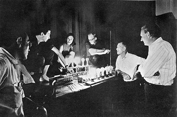 Test of the TEEM system. From left: Herb Scheinder, Robert Rauschenberg, Lucinda Childs, Robby Robinson, Per Biorn, Billy Klüver. Photo Franny Breer.