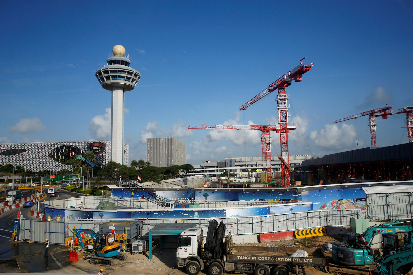 Construction takes place next to the Changi Airport control tower for Project Jewel in Singapore August 17, 2016. REUTERS/Edgar Su
