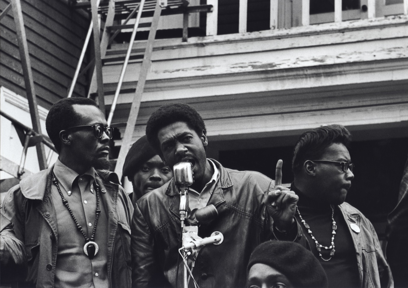 Stephen Shames Oakland, California, USA: Black Panther Chairman and co-founder Bobby Seale speaks at a Free Huey rally in Defermery Park (named by the Panthers Bobby Hutton Park) in West Oakland. Left of Seale is Bill Brent, who later went to Cuba. Right is Wilford Hol, July 28, 1968 Gelatin silver, printed 2006 16 x 20 in Signed and numbered by photographer verso; Edition of 8 + 2 Aps