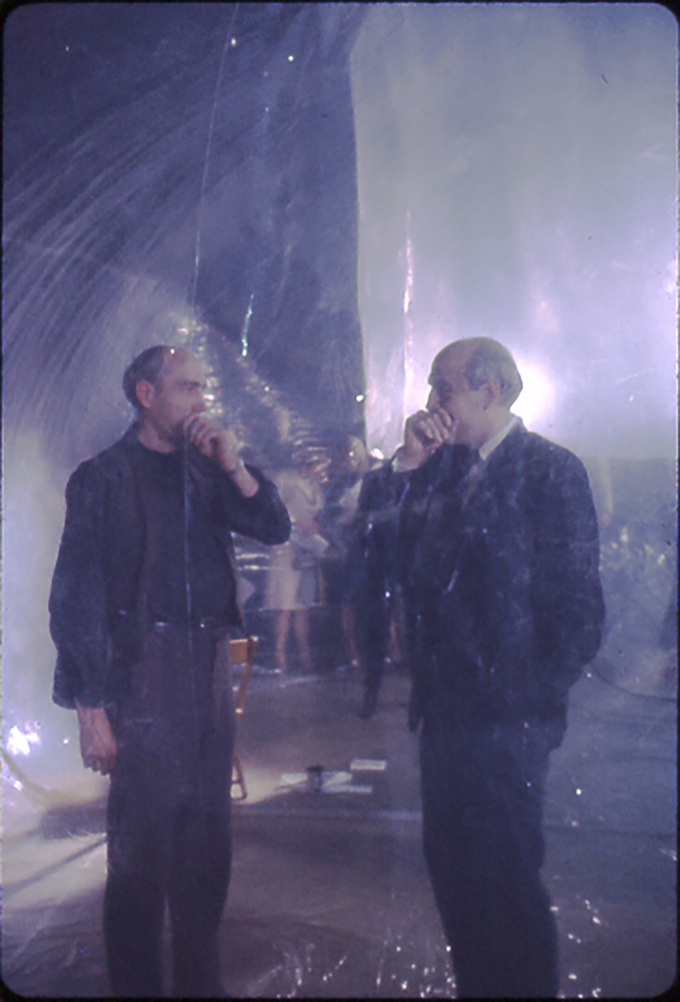 Michael Kirby and his twin brother standing as performers in Steve Paxton's inflated structure. Photo by Robert R. McElroy