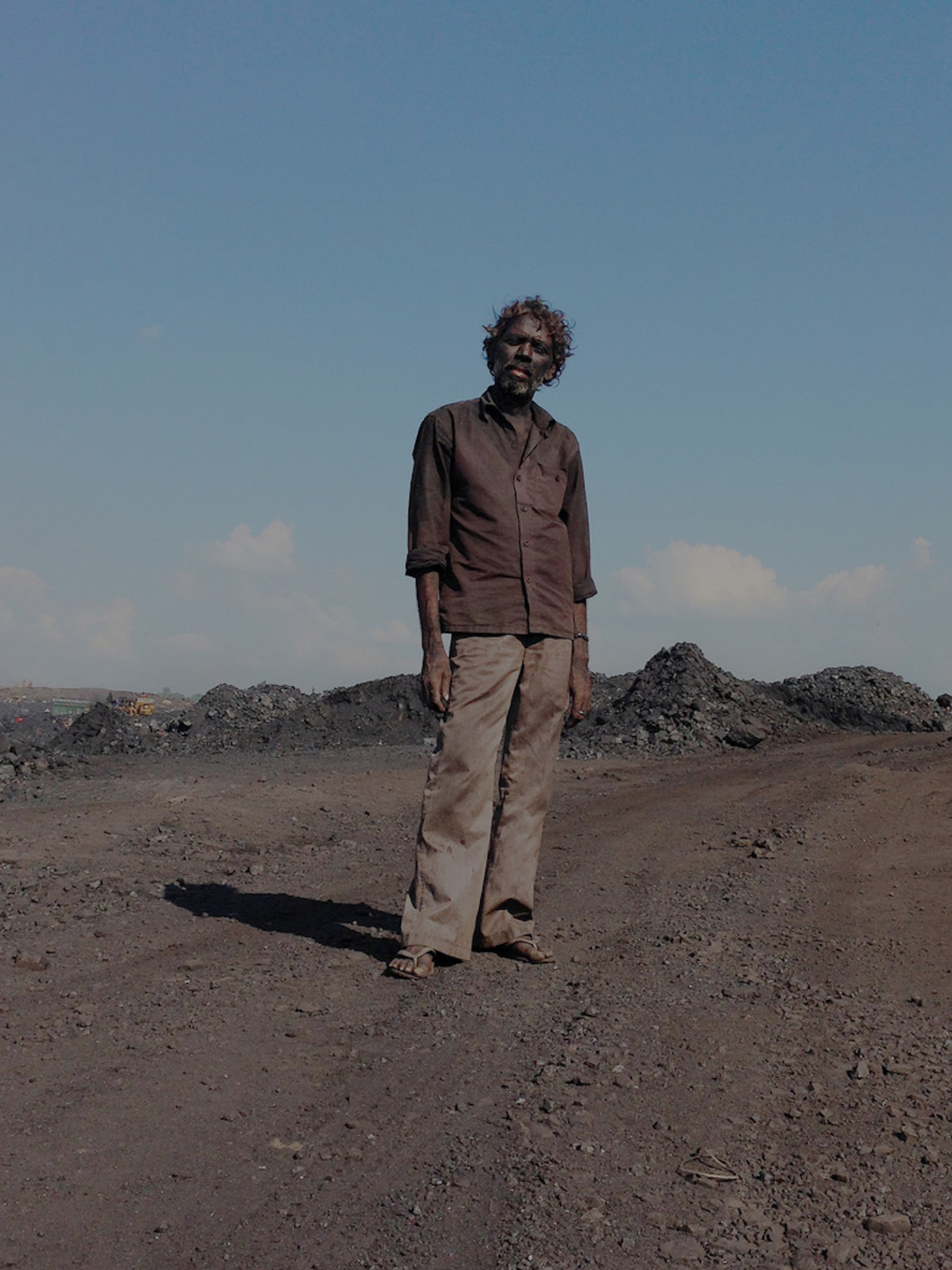 A contractual labour inside one of the coal mines in Jharia. He will make two dollars after loading almost five trucks with coal in Jharia.