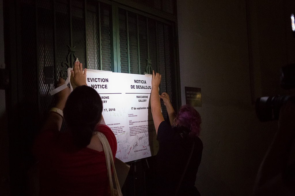 Protesters post eviction notices on the gates of Maccarone Gallery, September 16, 2016 (photo courtesy of Timo Saarelma)