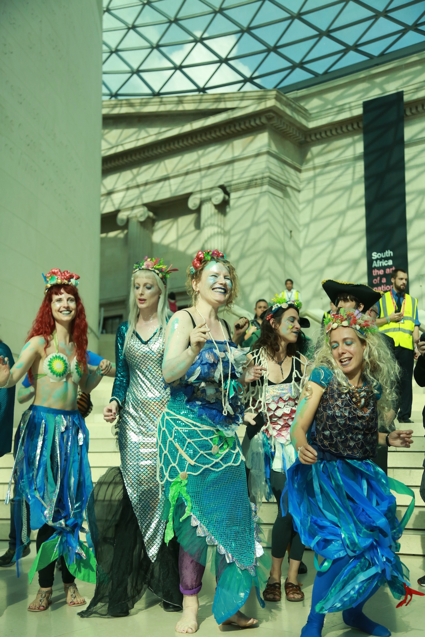 The merfolk chorus sing to thank BP for more 'Sunken Cities' during Sunday's performance protest at the British Museum.