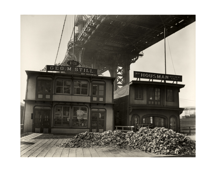 """Berenice Abbott, """"Oyster Houses, South Street and Pike Slip, Manhattan"""" (April 1, 1937), gelatin silver print photograph (courtesy of the Photography Collection, Miriam and Ira D. Wallach Division of Art, Prints and Photographs, The New York Public Library, Astor, Lenox and Tilden Foundations)"""