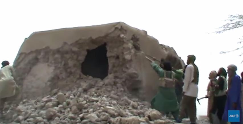 Islamists in 2012 destroying shrines in Timbuktu (screenshot via AFP/Youtube)