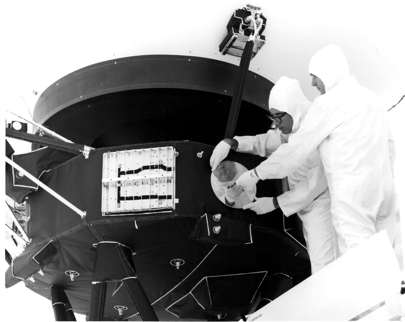 The gold-plated record being attached to Voyager 1 (July 29, 1977) (via NASA/Wikimedia)