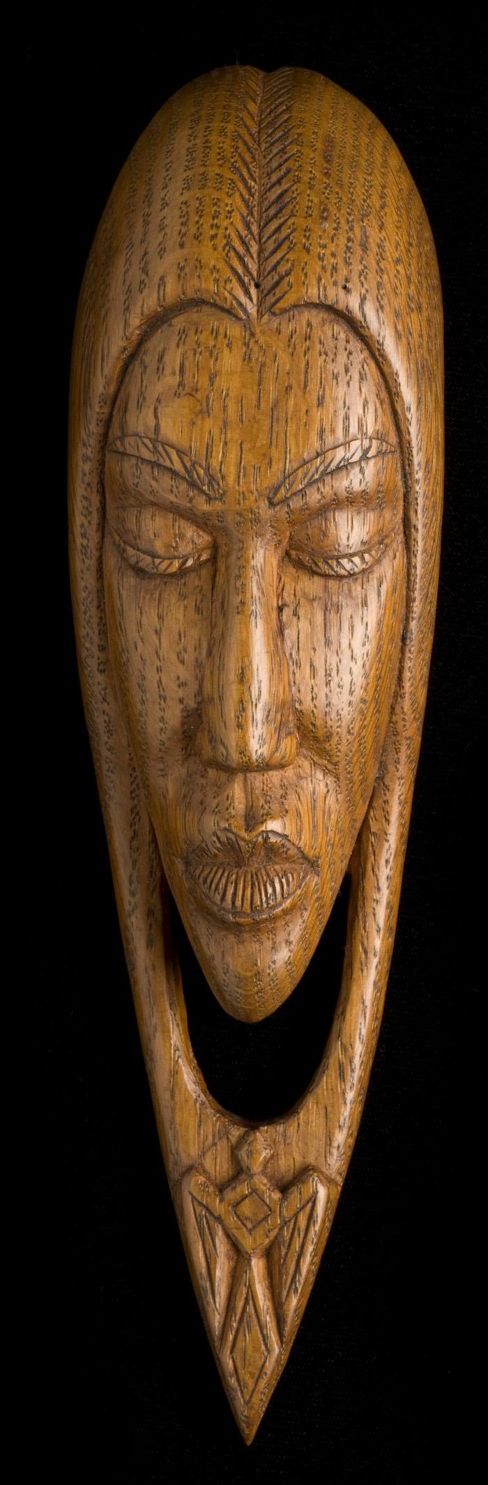 "Willard Stone, ""Modernistic Indian Girl"" (1946), oak wood, 9 x 2 1/2 x 1 3/4 inches (courtesy Gilcrease Museum)"
