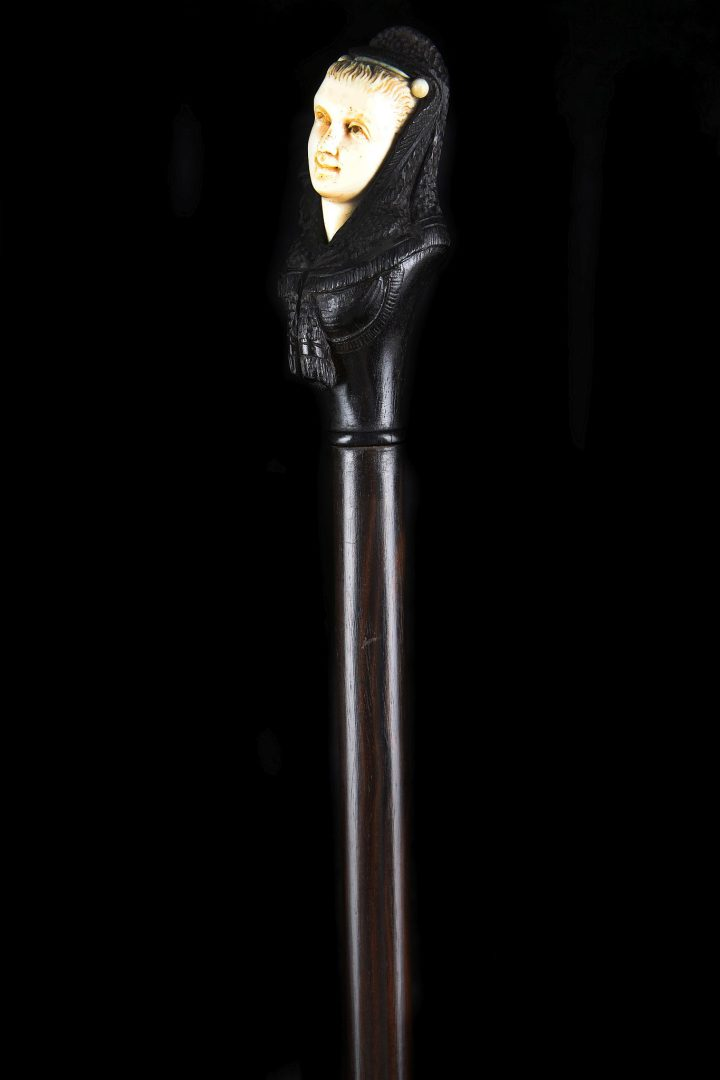 Ebony and ivory walking stick in the form of a Spanish lady (c. 1900)