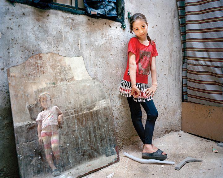"Rania Matar, ""Amal 9, Zahra 5 (girl in the mirror), Beirut"" (2014)"