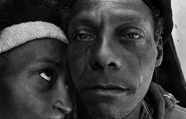 Caption: Fred, who has just returned from prison, weeps as he greets his former girlfriend Rose in a New York City shantytown. Title: Back from prison, Shantytown, New York City, 1986