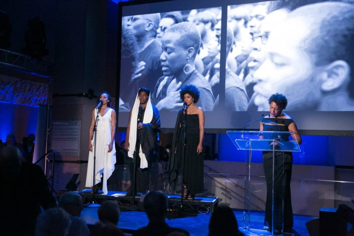 Carrie Mae Weems performing Past Tense with performers (from left to right) Eisa Davis, Imani Uzuri and Alicia Hall Moran, in a multi-media work incorporating song, text, projection and video, 2016.