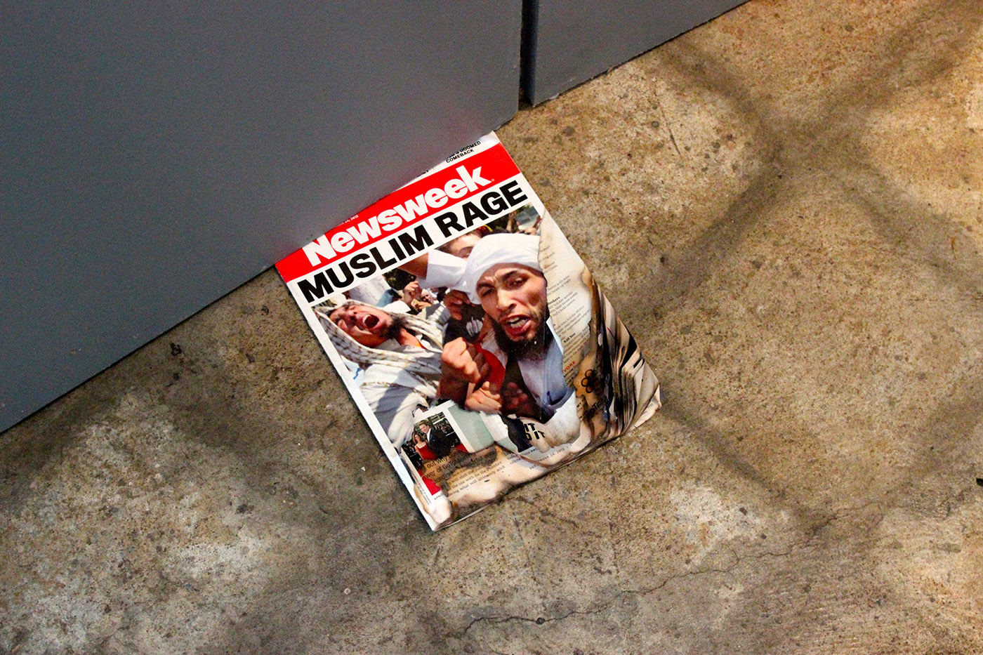 """""""Muslim Rage"""" by Osman Khan juxtaposes the media characterization of Muslim anger with the artists own act of aggression towards the publication."""