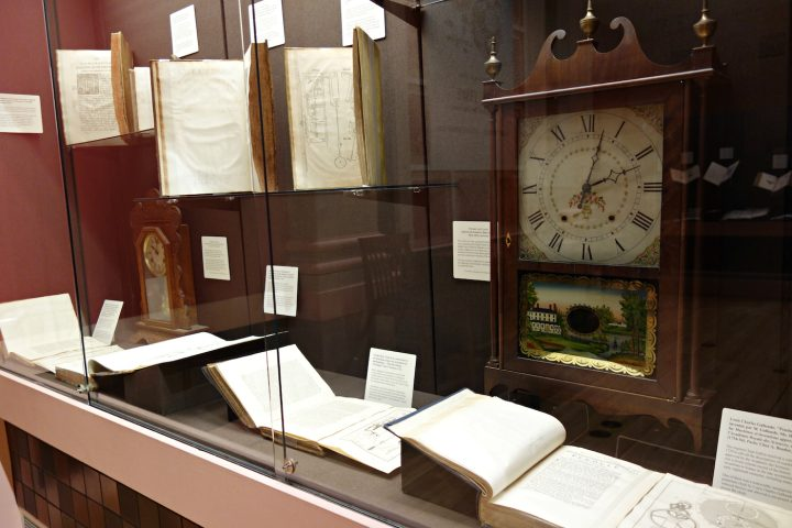 Installation view of 'On Time: The Quest for Precision. Books on Time and Timekeeping from the Linda Hall Library' at the Grolier Club (photo by the author for Hyperallergic)