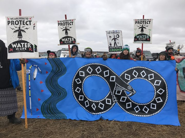 A banner by artist Jesse Hazelip at the frontlines near Oceti Sekawan Camp at Standing Rock (photos by the author for Hyperallergic)