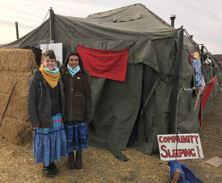 Artists Rebecca Nagle and Graci Horne by the tent they are conducting their healing events.