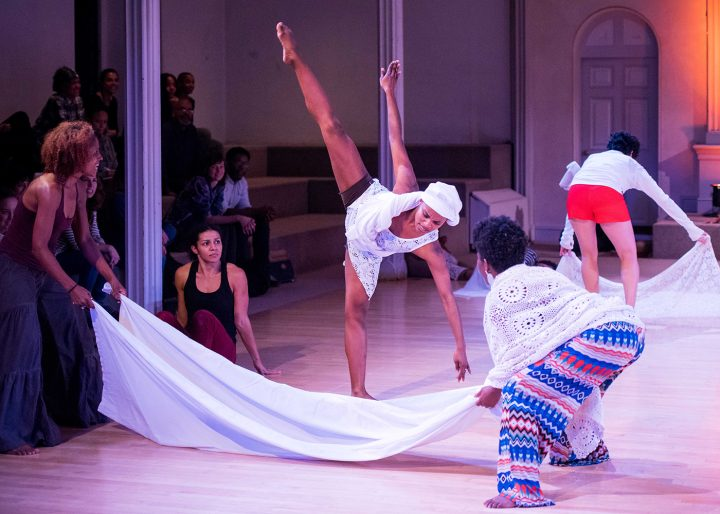 From left to right in the foreground: Rakiya Orange, Maria Bauman, Charmaine Warren, Davalois Fearon, and Edisa Weeks. Performing in the skeleton architecture, or the future of our worlds, Danspace Project. Photo: Ian Douglas/courtesy Danspace Project.
