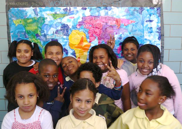 Youth at The Children's Art Carnival in front of a mural they created. Courtesy of Marline A. Martin.