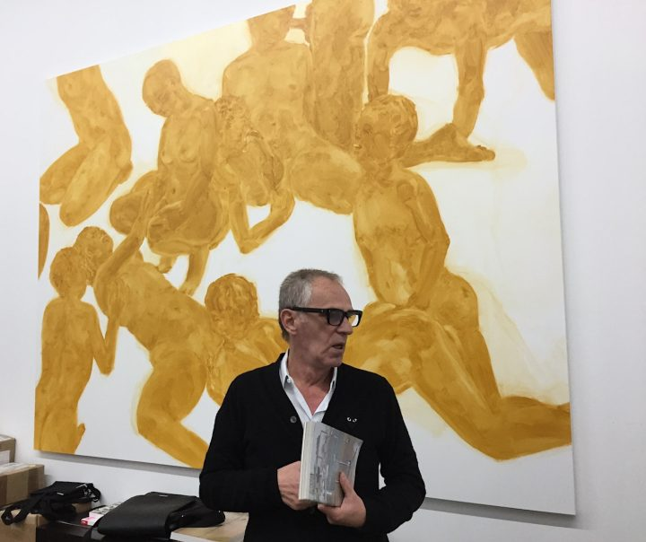 Mihai Nicodim in front of a painting by Philipp Kremer.