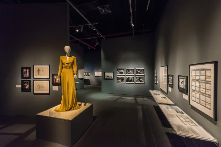 In the foreground, a costume designed by Sandy Powell and worn by Cate Blanchett as Kathryn Hepburn in <em>The Aviator</em> (2004) in <em>Martin Scorsese</em> at the Museum of the Moving Image (photo by Thanassi Karageorgiou, courtesy the Museum of the Moving Image)