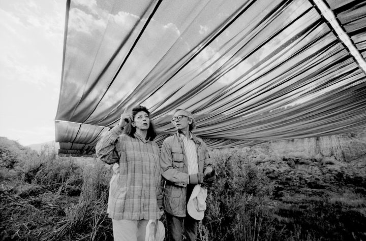 """Christo and Jeanne-Claude during the life-size test for """"Over The River,"""" summer 1999 (photo by Wolfgang Volz, © 1999 Christo)"""