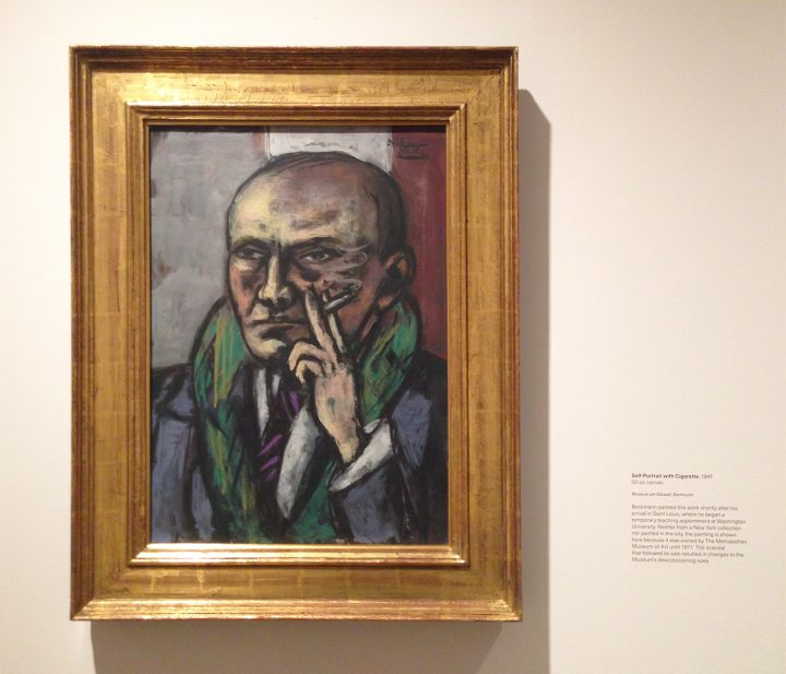 """Installation view of <em>Max Beckmann in New York</em> at the Metropolitan Museum of Art with Max Beckmann, """"Self-Portrait with Cigarette"""" (1947), oil on canvas, 25 x 17 15/16 in, Museum Ostwall, Dortmund (photo by Hyperallergic)"""